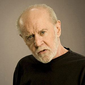 Photograph of George Carlin.
