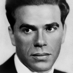A photograph of Frank Capra.