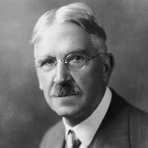 A photograph of John Dewey.