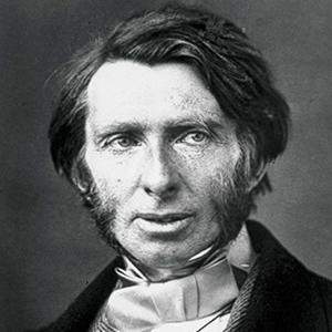 A photograph of John Ruskin.