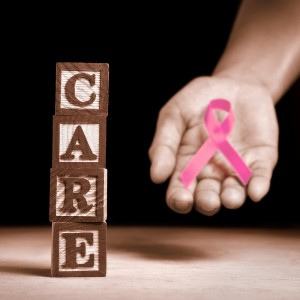 Cancer Control Month with a pink ribbon.