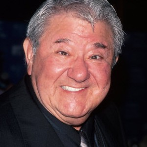 A photograph of Buddy Hackett.