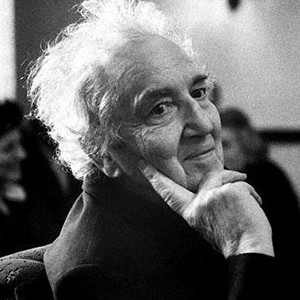 A photograph of Robert Graves.