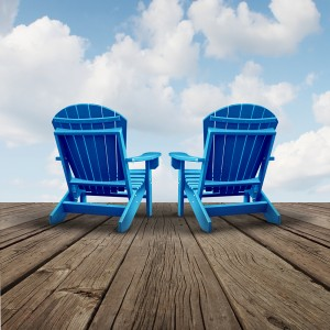 Retirement and relaxation with two chairs on a patio deck.