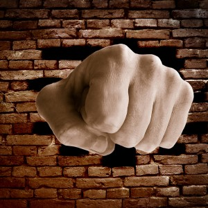 Anger expressed by putting fist through a brick wall.