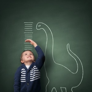 Growth of young boy measured on a blackboard.